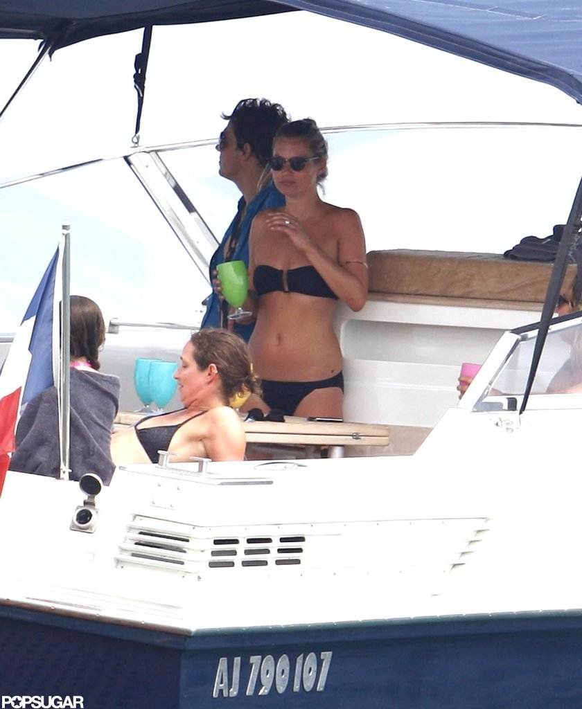 Kate Moss hung out on a boat wearing a black bikini.