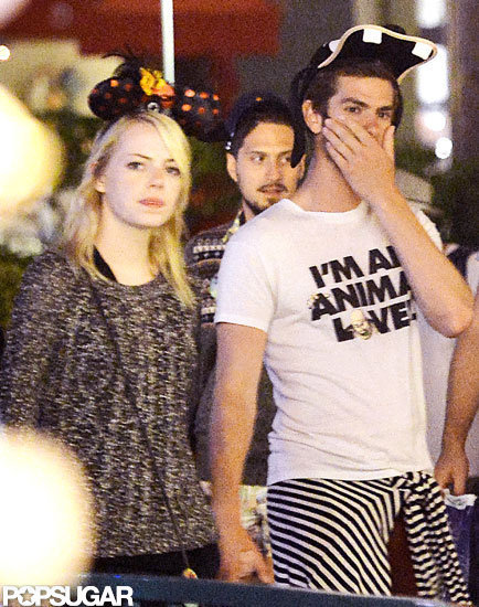 Emma Stone and Andrew Garfield wore hats and held hands while visiting Disneyland.