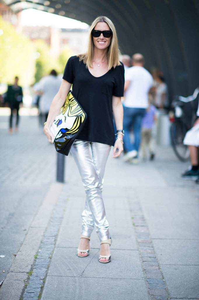 Metallic pants offset a basic black tee — as does her oversized statement clutch. Still, relaxed, easy proportions make this totally accessible. Source: Adam Katz Sinding