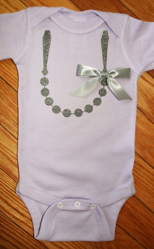 Carrie Bradshaw Pearl Necklace Onesie ($20)