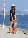 Anja, Alessandra Ambrosio's daughter, wore a nautical-inspired striped swimsuit on a Malibu Beach in July.