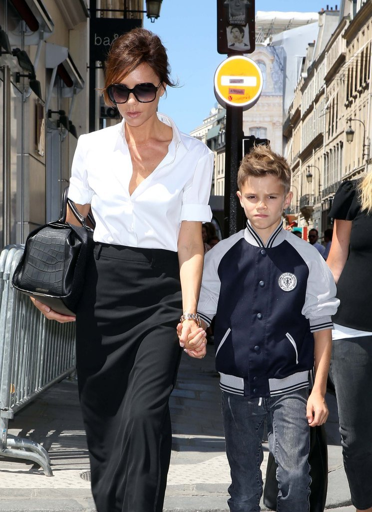 In July, Romeo Beckham shopped with his mom Victoria Beckham while sporting a varsity-style jacket and dark jeans.