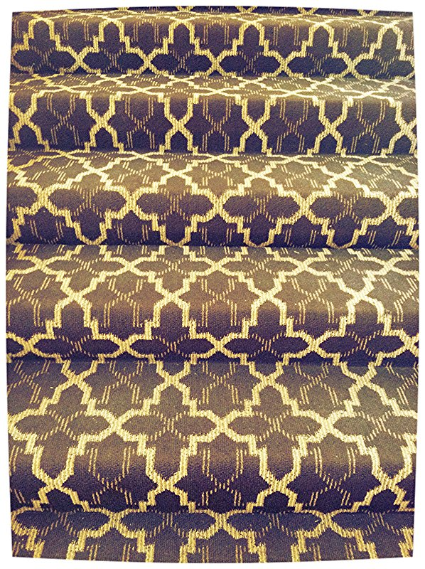 While carpeted steps could very easily look dated, the modern Moroccan graphic in chocolate and cream keeps it fresh.