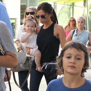 Victoria Beckham Wearing Black Scalloped Top