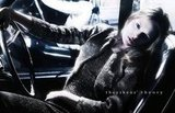 A cool tweed suit gets the front-seat treatment in Theyskens' Theory's latest ads.