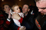 Mike Huckabee held one of the smallest supporters at a January 2012 campaign rally in Cedar Rapids, IA.