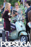 Blake Lively and Penn Badgley stood next to a Vespa before climbing on.