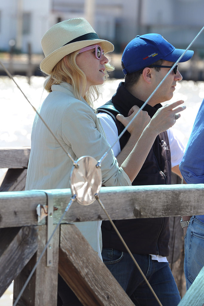 Naomi Watts prepared to board a boat.