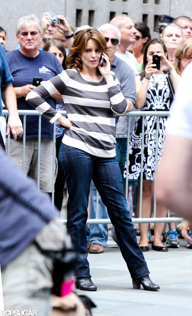 Tina Fey chatted on the phone in front of onlookers and extras.