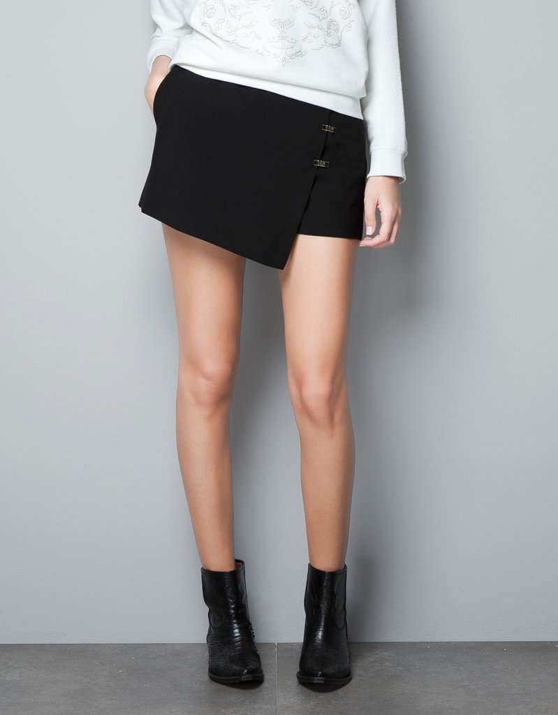 The functionality of shorts in Fall's must-have wrap-skirt silhouette all, er, wrapped into one awesome piece. Add our silky button-down and booties and we're set for a full day of shows.  Zara Crossover Shorts ($60)
