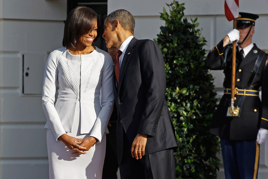 Barack whispered in Michelle's ear at the White House.