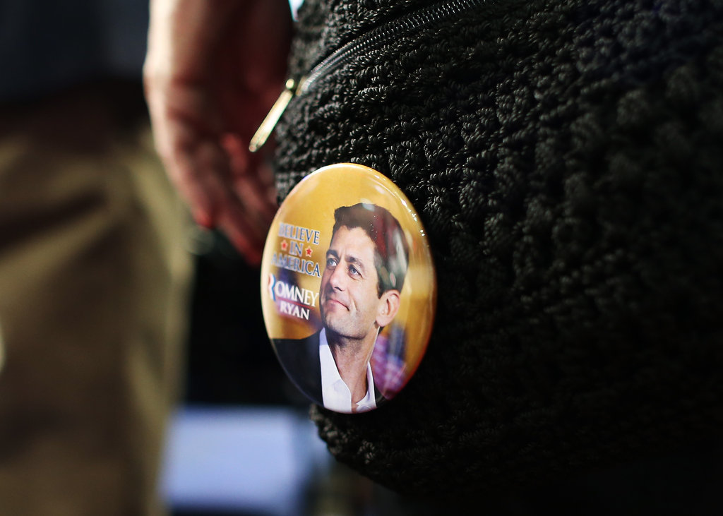 A female attendee decorated her purse with a Paul Ryan pin.