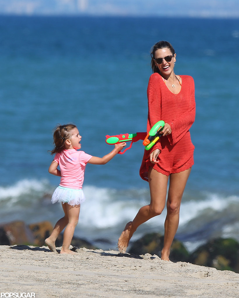 Alessandra Ambrosio and her daughter, Anja, got playful on the beach in Malibu in July.