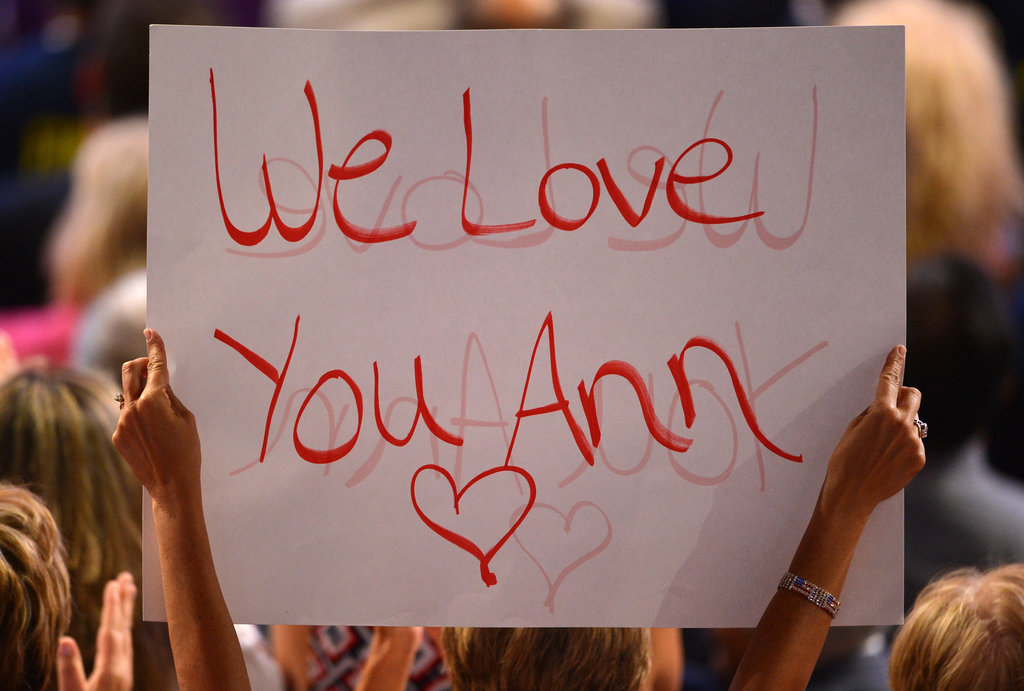 A female convention attendee held up a sign for Ann Romney.
