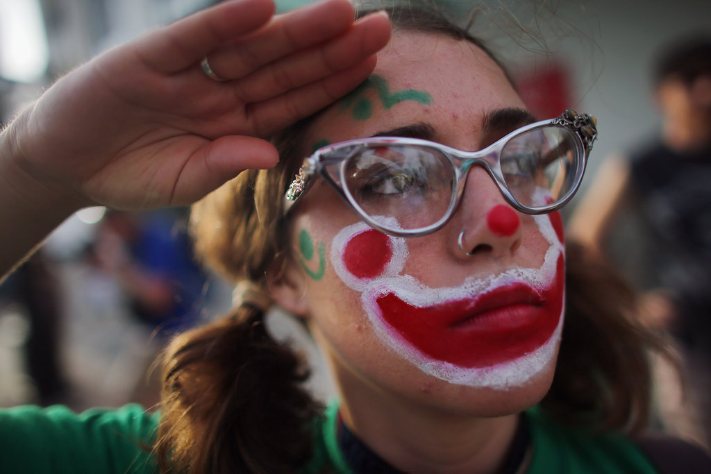 A girl wore face paint while protesting.