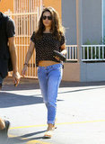 Mila Kunis showed off her abs in a cropped top.