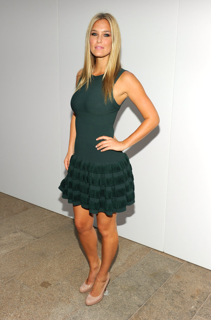 Bar Refaeli struck a sexy pose in a green dress at the Fashion's Night Out runway show in 2010.