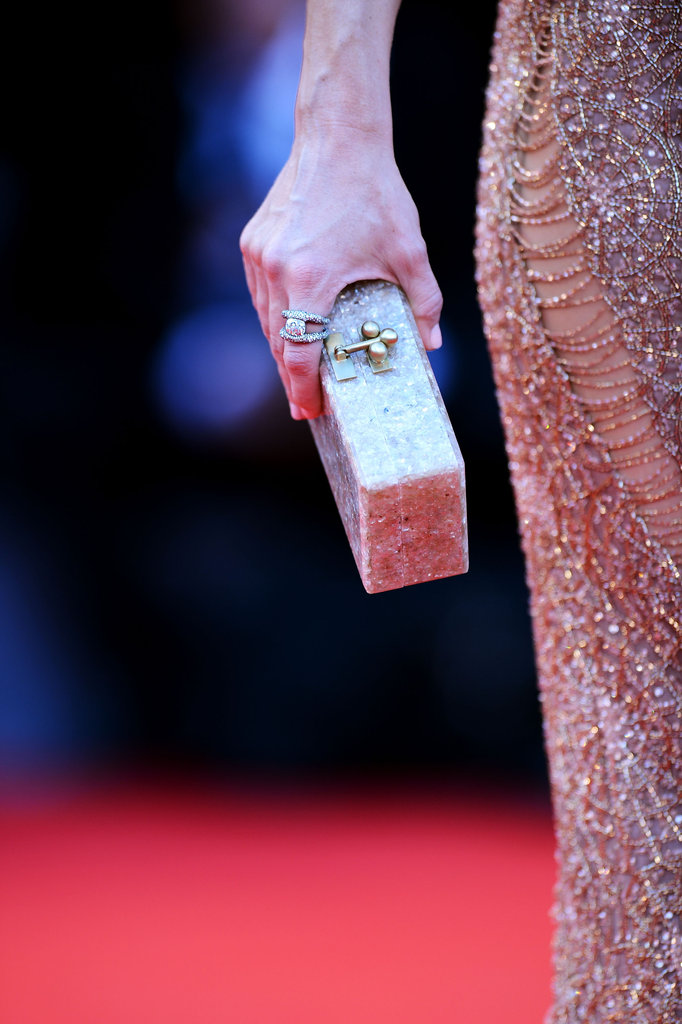Her jewel-encrusted Edie Parker clutch fit right in with her glitzy Atelier Versace gown.