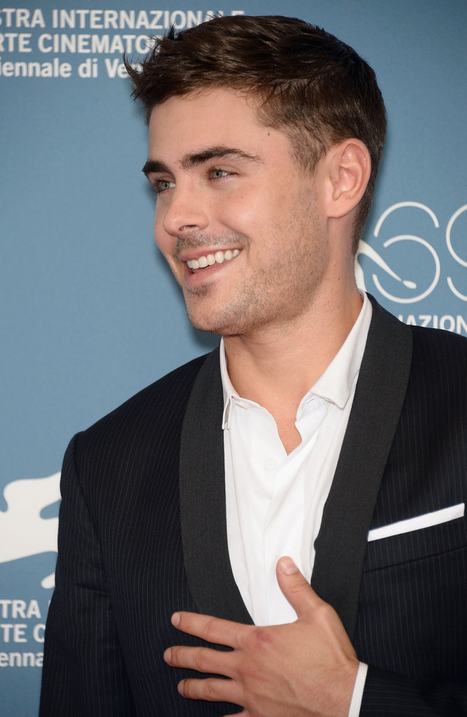 Zac Efron smiled at the At Any Price photocall at the Venice Film Festival.