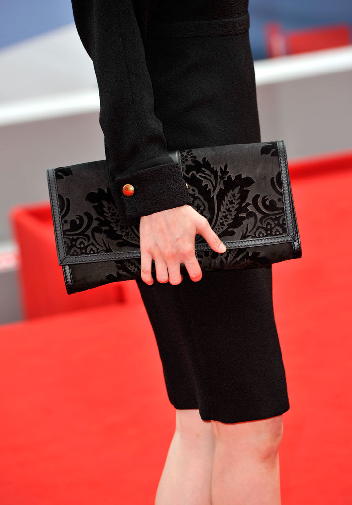 Her black brocade-inspired clutch provided an interesting twist to her all-black ensemble.