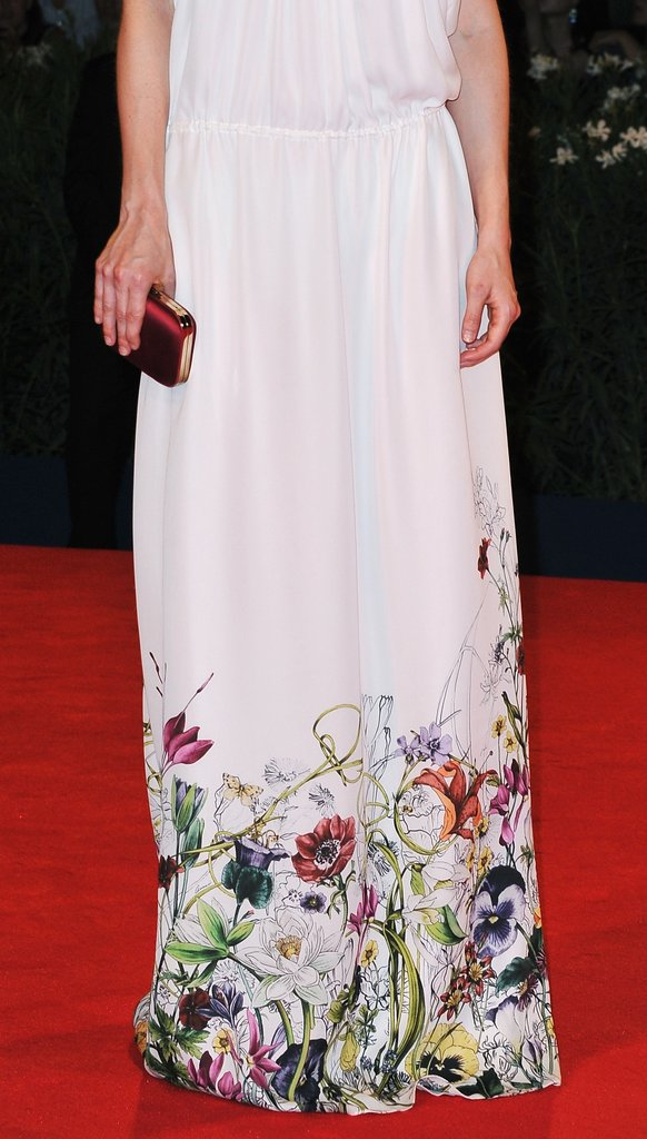 The bright floral print at the bottom of Brit's Gucci gown lit up the otherwise stark white canvas of her dress.
