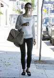 Jordana Brewster showed off the chicest kind of transitional style in a Madewell sweater and cheeky Tory Burch loafers.