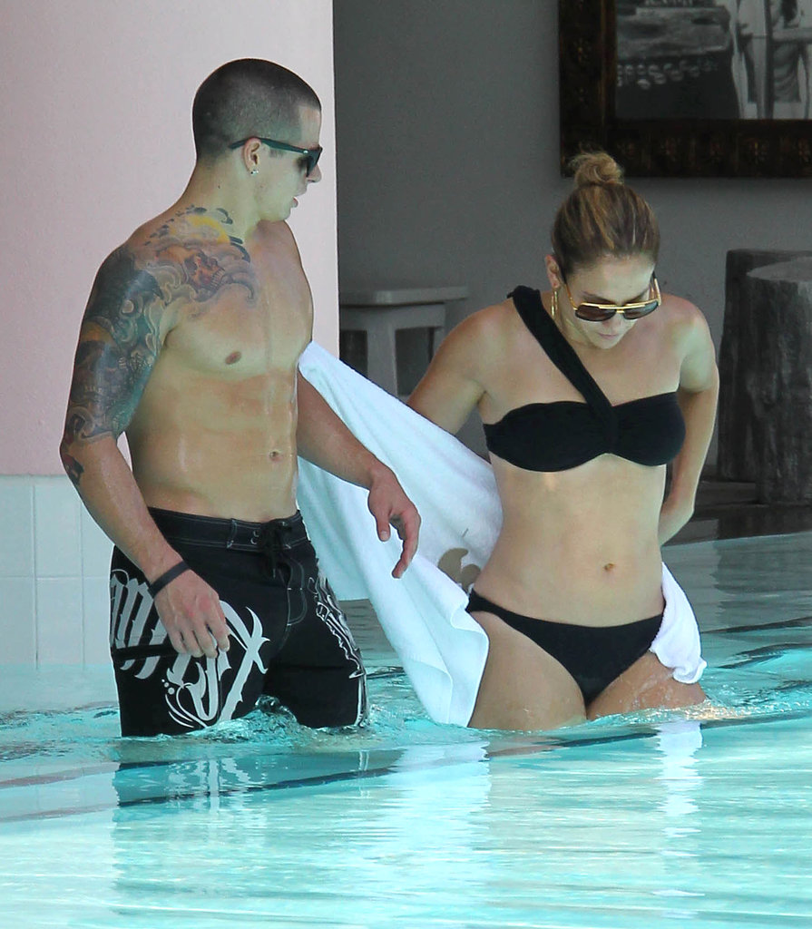 Jennifer Lopez wore a sexy black bikini in the pool with Casper Smart.