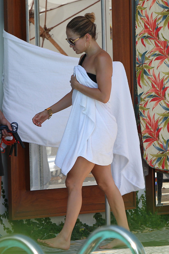 Jennifer Lopez wore a black bikini and wrapped herself in a towel.
