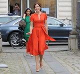 Crown Princess Mary of Denmark looked radiant in this orange Marc Jacobs dress. We love the dress' casual and feminine feel, and how the belt cinches in and highlights Mary's fabulous figure. Her nude pumps match her skin tone to perfection, so her legs look like they go for miles. All together, it's a polished and stylish look fit for a, um, princess.