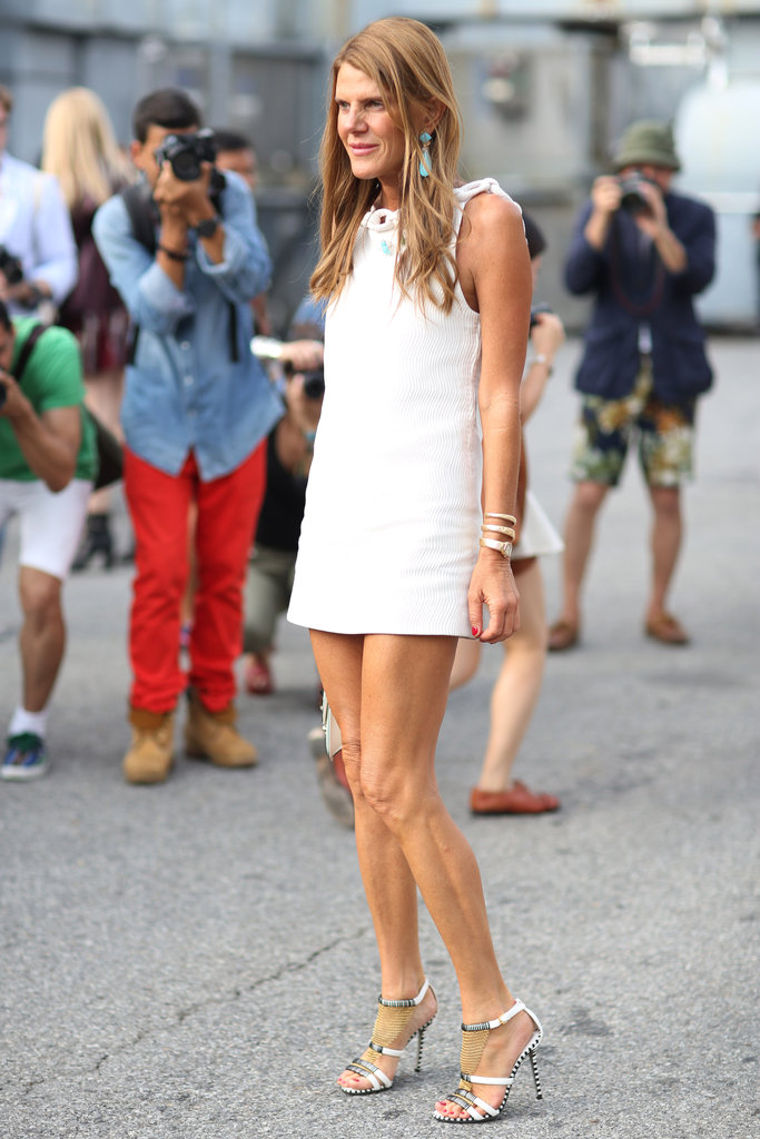 Anna Dello Russo caused a photo frenzy (per usual) with her stem-baring LWD.