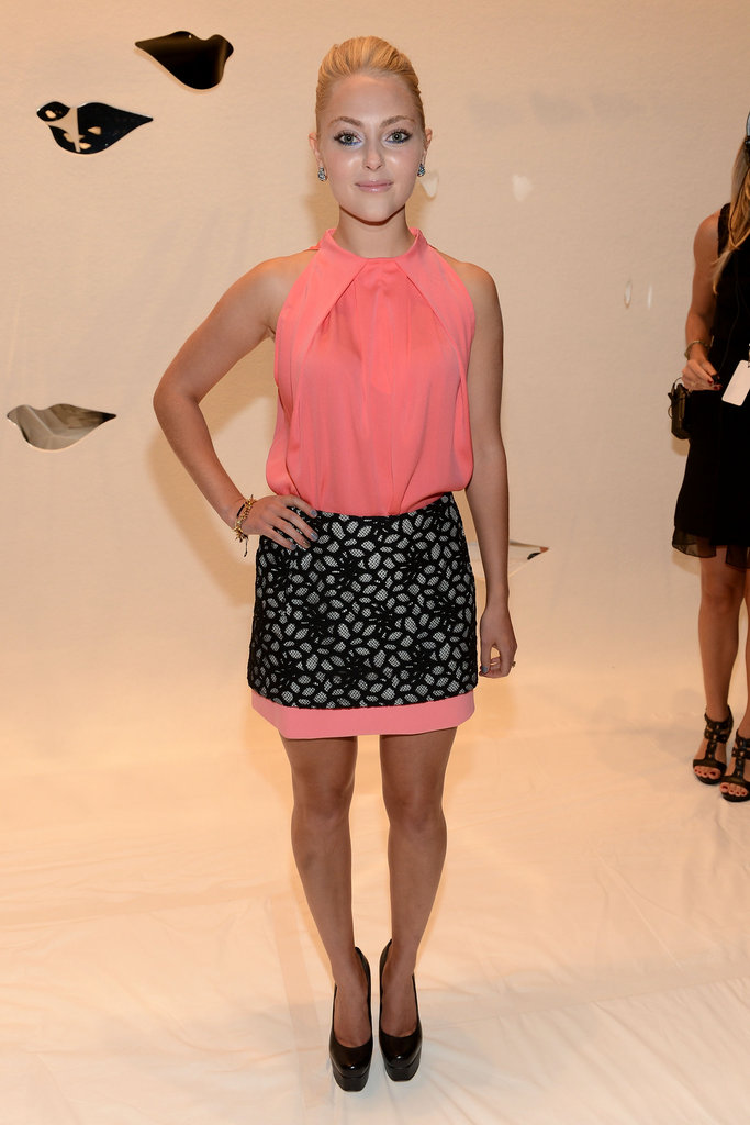 AnnaSophia Robb styled up her round-toe pumps with a coral pink cocktail dress, adorned with black lace, at the Diane von Furstenberg show.
