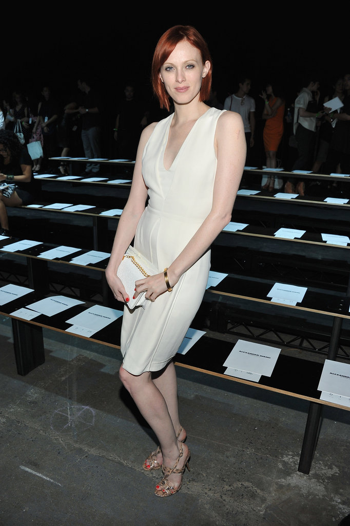 Karen Elson's pretty ivory-hued shift looks pretty against her white clutch and gold sandals — a simple and minimalist-cool look, perfect for Alexander Wang's Spring 2013 show.