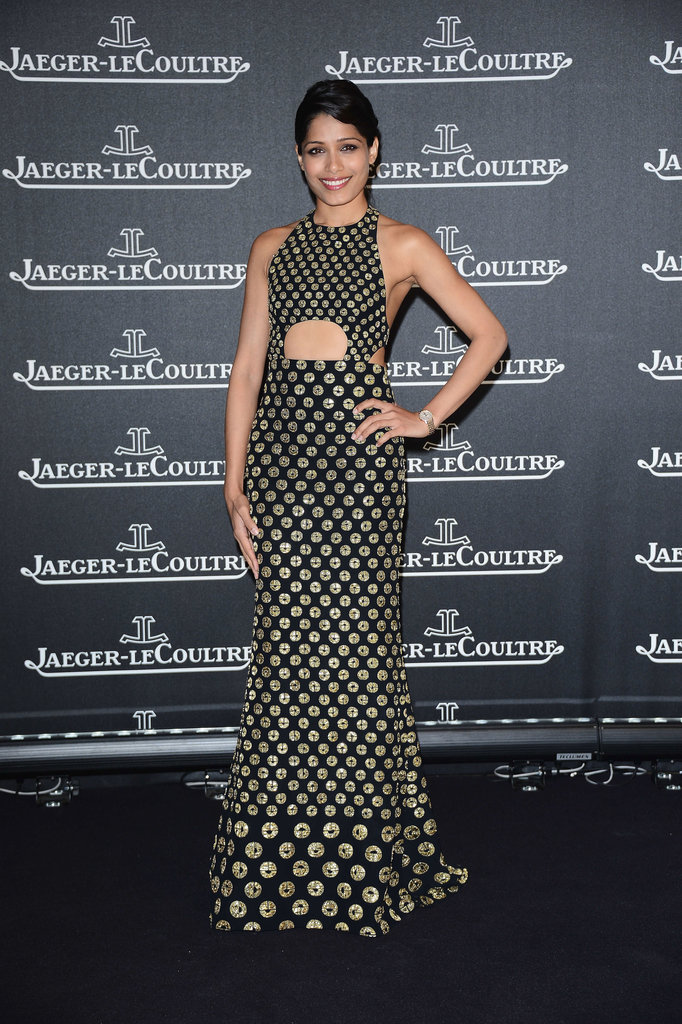 Freida Pinto wore a black and gold gown with a sexy cutout.
