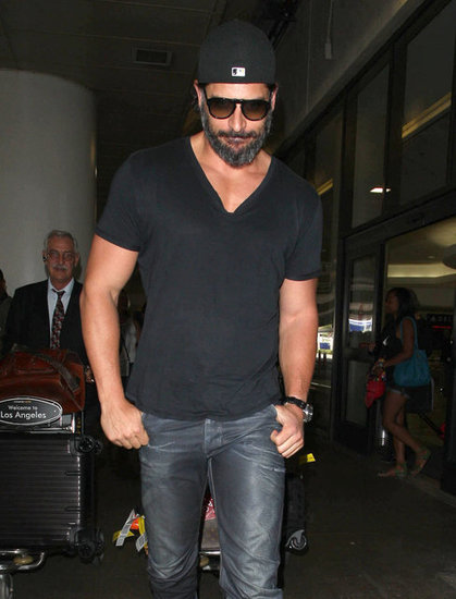 Joe Manganiello tucked his hands in his pockets while walking out of LAX.