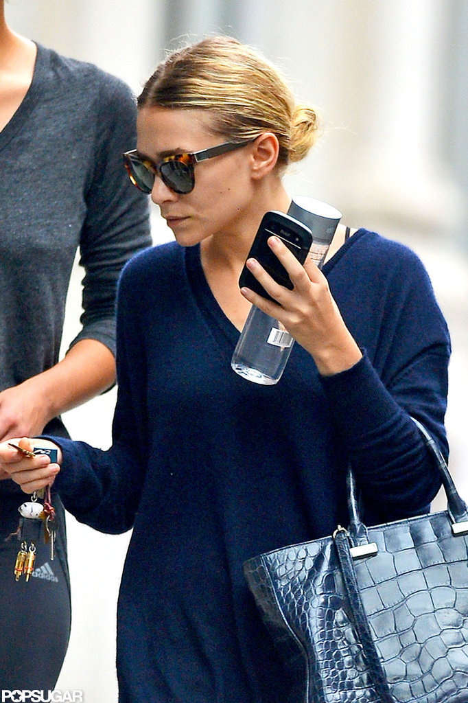 Ashley Olsen carried a large water out with her in NYC.