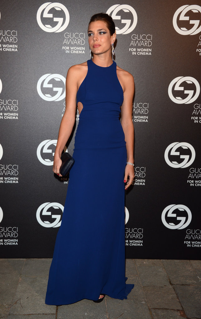 Charlotte Casiraghi struck a particularly sporty silhouette in this minimalist blue silk gown by Gucci. The halter neck and side cutouts flatter Charlotte's athletic, yet svelte, body.