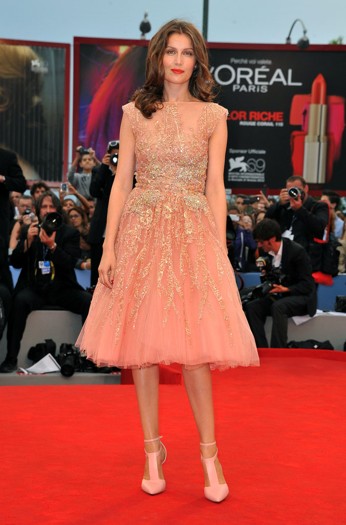 Laetitia Casta looked ethereal in a peachy number from the Elie Saab Couture Fall 2012 collection. She wore her hair loose and wavy with a matte red lip and matching pink pumps.