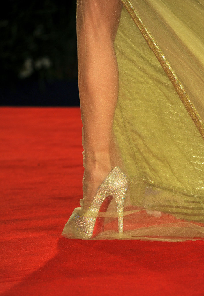 Her crystal-encrusted Christian Louboutin pumps added even more shine to her Georges Chakra Couture look.