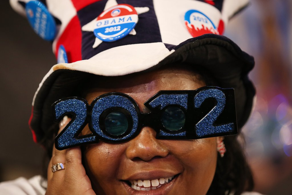 A lady wore 2012 sunglasses inside the convention.