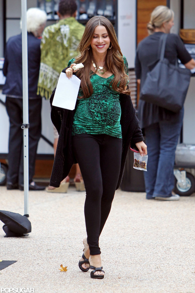 Sofia Vergara wore black leggings and a green top on set.