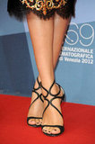 These Jimmy Choo sandals have been a red-carpet staple all Summer, and here we're seeing them take on a darker Fall glamour.