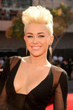 Miley Cyrus styled her hair up.
