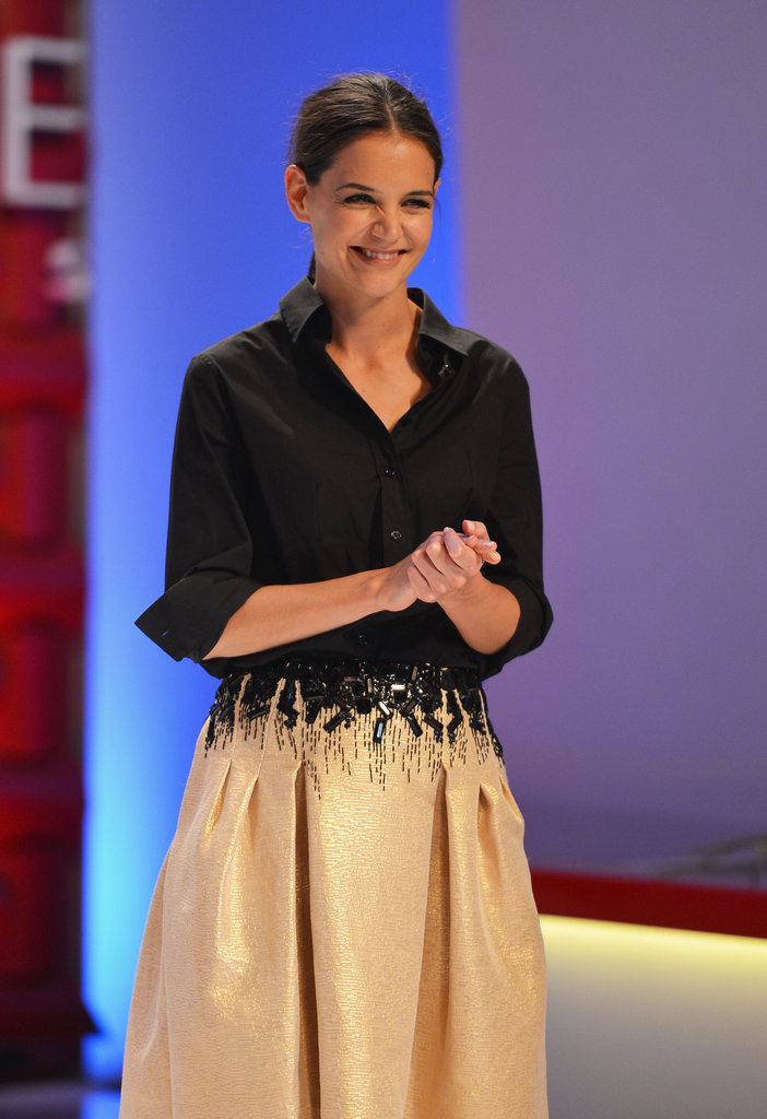 Katie Holmes smiled on stage at the Style Awards.