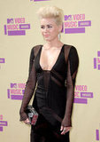 Miley Cyrus's black gown had a plunging neckline.