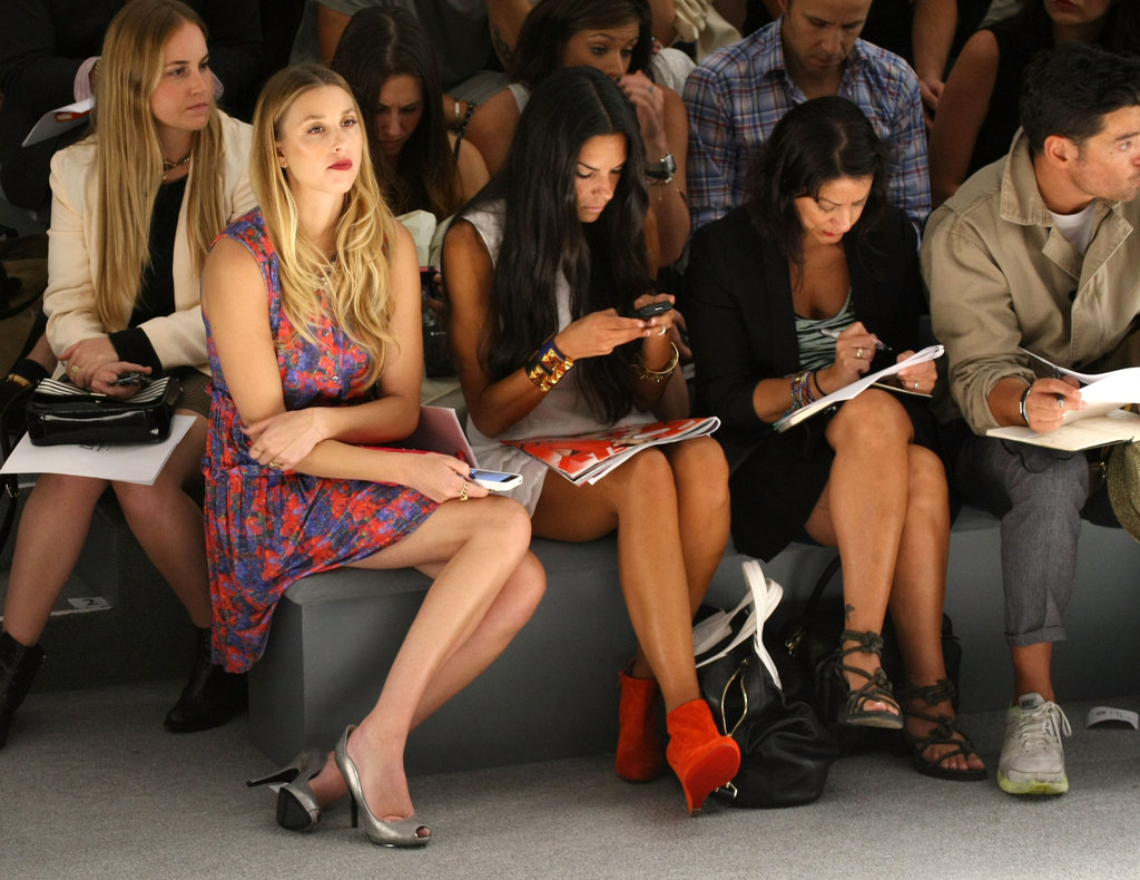 We spotted Whitney Port, front and centre, at Nicholas K in a brightly printed dress and metallic silver peep-toe pumps.