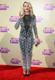 Rita Ora wore a custom Emilio Pucci jumpsuit and Louboutin pumps.