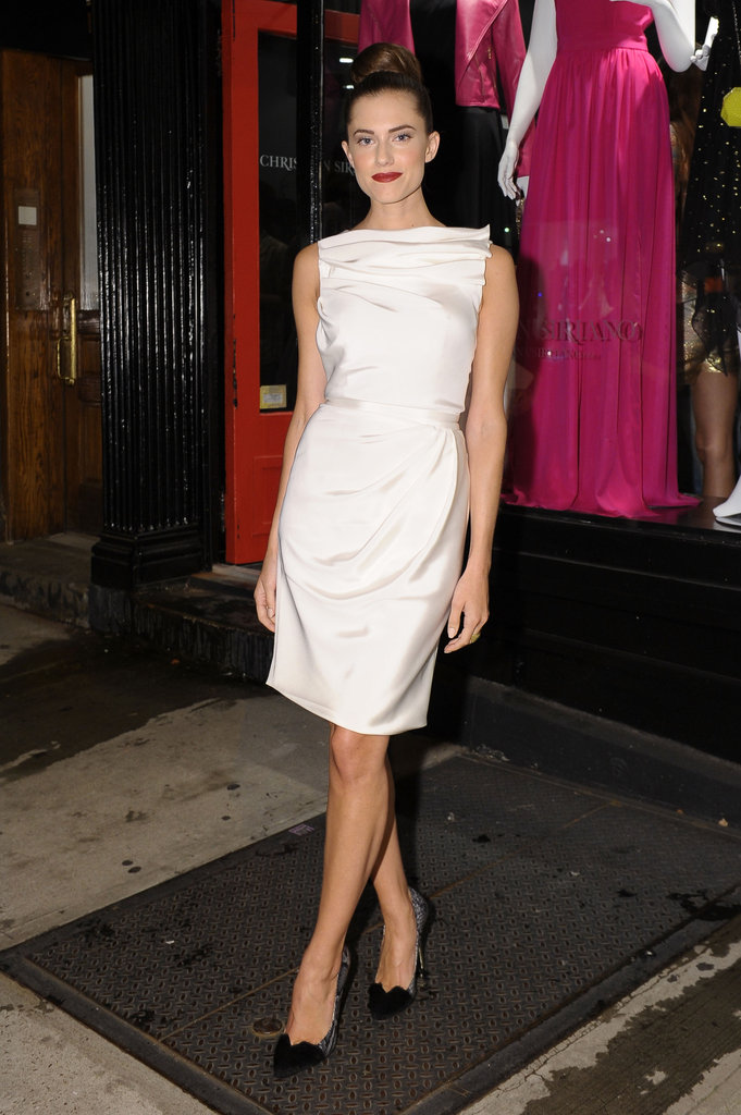 Girls' Allison Williams chose a chic white sheath to celebrate Fashion Week and Christian Siriano's store.