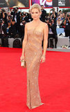 Kate Hudson stole the limelight in a nude Versace gown at the Venice Film Festival.