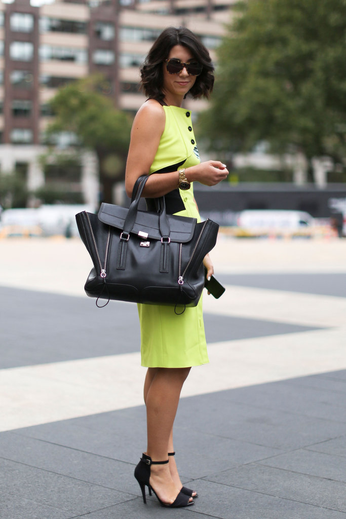 Neon isn't dead yet, folks: we love how this street styler grounded her fresh pop of color with dark accessories.