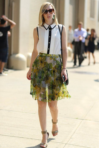 The effect of adding a black and white blouse to a printed skirt? Impossibly chic. Source: Greg Kessler